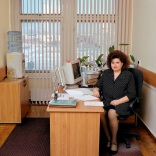 """Russia, bureaucracy, Siberia, province Tomsk, 2004. Russia-19/2004 [Tom., MNB (b. 1962)]. Marina Nikolayevna Berezina (b. 1962), a former singer and choir director, is now the secretary to the head of the financial department of Tomsk province""""s Facility Services. She does not want to reveal her monthly salary."""