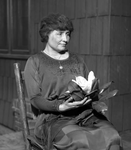 Helen Keller holding a magnolia ca 1920