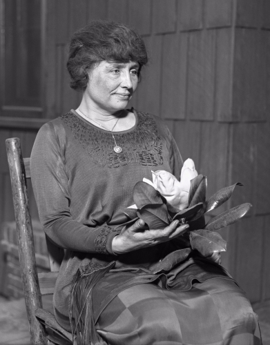 Los Angeles Times - Helen Keller holding a magnolia flower (circa 1920)